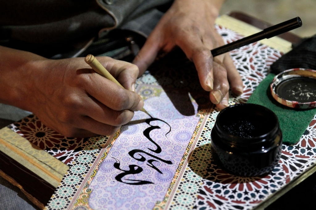 Close-up of Man Writing Arabic Calligraphy